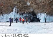 Купить «Baikal Lake. A group of tourists travels around the island of Olkhon and photograph icy coastal rocks and grotto», фото № 29475622, снято 8 марта 2015 г. (c) Виктория Катьянова / Фотобанк Лори