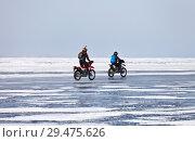Купить «LAKE BAIKAL, IRKUTSK REGION, RUSSIA -  March 08, 2015: Two girls travels by motorcycles on the ice of the frozen Small Sea Strait around Olkhon Island», фото № 29475626, снято 8 марта 2015 г. (c) Виктория Катьянова / Фотобанк Лори