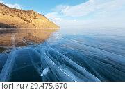 Купить «Lake Baikal. The endless expanses of beautiful blue smooth ice to the horizon. Unusual winter landscape», фото № 29475670, снято 28 февраля 2015 г. (c) Виктория Катьянова / Фотобанк Лори