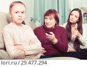 Купить «Offended little while mom and granny scolding her», фото № 29477294, снято 25 ноября 2017 г. (c) Яков Филимонов / Фотобанк Лори