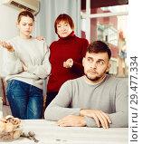Купить «Chagrined guy having problems in relationship with family», фото № 29477334, снято 27 ноября 2017 г. (c) Яков Филимонов / Фотобанк Лори