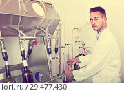 Купить «attentive man making tests in wine manufactory laboratory», фото № 29477430, снято 19 января 2019 г. (c) Яков Филимонов / Фотобанк Лори