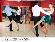 Купить «People dancing rock-and-roll in pairs», фото № 29477594, снято 4 октября 2018 г. (c) Яков Филимонов / Фотобанк Лори