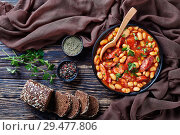 hearty beans stew in a bowl. Стоковое фото, фотограф Oksana Zh / Фотобанк Лори