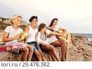 Купить «Group of young musicians having fun on the beach», фото № 29478382, снято 22 июля 2018 г. (c) Сергей Новиков / Фотобанк Лори