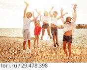 Купить «Cute teens jumping together on the beach in summer», фото № 29478398, снято 22 июля 2018 г. (c) Сергей Новиков / Фотобанк Лори