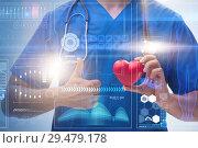 Купить «Young doctor cardiologist in telehealth concept», фото № 29479178, снято 26 марта 2019 г. (c) Elnur / Фотобанк Лори