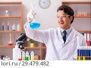 Купить «Young handsome biochemist working in the lab», фото № 29479482, снято 10 августа 2018 г. (c) Elnur / Фотобанк Лори