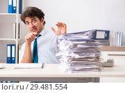 Купить «Overloaded busy employee with too much work and paperwork», фото № 29481554, снято 3 июля 2018 г. (c) Elnur / Фотобанк Лори