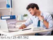 Купить «Overloaded busy employee with too much work and paperwork», фото № 29481562, снято 3 июля 2018 г. (c) Elnur / Фотобанк Лори