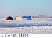 Купить «Three tourist tents on the ice of frozen Lake Baikal. Popular winter rest on ice fishing», фото № 29484954, снято 31 января 2015 г. (c) Виктория Катьянова / Фотобанк Лори