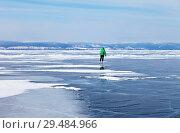 Купить «Baikal Lake. Girl skating near the island of Olkhon. Active winter outdoor recreation», фото № 29484966, снято 8 марта 2015 г. (c) Виктория Катьянова / Фотобанк Лори