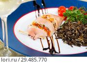 Купить «Image of stuffed squid with wild rice and cherry tomato», фото № 29485770, снято 22 августа 2019 г. (c) Яков Филимонов / Фотобанк Лори