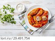 Купить «cabbage rolls on a white plate», фото № 29491754, снято 22 ноября 2018 г. (c) Oksana Zh / Фотобанк Лори