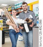 Купить «Positive young family demonstration variety instruments for repair house», фото № 29492086, снято 17 мая 2018 г. (c) Яков Филимонов / Фотобанк Лори
