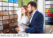 Купить «Competent seller in showroom helping young female client to choose furniture materials for her apartment», фото № 29492210, снято 9 апреля 2018 г. (c) Яков Филимонов / Фотобанк Лори