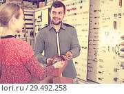 Купить «attentive male seller assisting woman in choosing door handles in shop», фото № 29492258, снято 5 апреля 2017 г. (c) Яков Филимонов / Фотобанк Лори