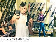 Купить «Guy taking selfie with rifle», фото № 29492286, снято 4 июля 2017 г. (c) Яков Филимонов / Фотобанк Лори