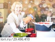 Купить «Woman posing with ceramic tableware», фото № 29496410, снято 31 октября 2016 г. (c) Яков Филимонов / Фотобанк Лори