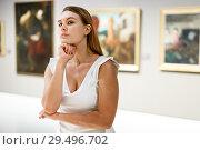 Купить «Woman observing museum exposition», фото № 29496702, снято 28 июля 2018 г. (c) Яков Филимонов / Фотобанк Лори