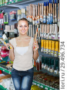 Купить «Portrait of female customer choosing brush», фото № 29496734, снято 10 декабря 2018 г. (c) Яков Филимонов / Фотобанк Лори