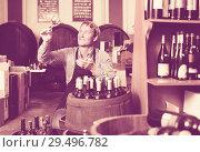 Купить «winemaker holding glass of wine in cellar», фото № 29496782, снято 18 декабря 2018 г. (c) Яков Филимонов / Фотобанк Лори