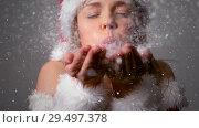 Купить «Video composition with falling snow over girl in santas suit blowing snow», видеоролик № 29497378, снято 13 декабря 2018 г. (c) Wavebreak Media / Фотобанк Лори