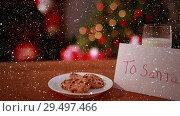 Купить «Video composition with falling snow over desk with cookies and christmas tree», видеоролик № 29497466, снято 4 августа 2020 г. (c) Wavebreak Media / Фотобанк Лори