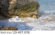 Купить «Waves wash the sandy shore. Ridge is broken on the rocks», видеоролик № 29497838, снято 26 марта 2019 г. (c) Константин Мерцалов / Фотобанк Лори