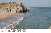 Купить «Waves wash the sandy shore. Ridge is broken on the rocks», видеоролик № 29498034, снято 26 марта 2019 г. (c) Константин Мерцалов / Фотобанк Лори