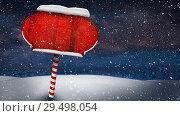 Купить «Video composition with snow over winter scene with red blank sign», видеоролик № 29498054, снято 13 декабря 2018 г. (c) Wavebreak Media / Фотобанк Лори