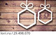 Купить «Video composition with snow over Christmas ornaments on wood», видеоролик № 29498070, снято 13 декабря 2018 г. (c) Wavebreak Media / Фотобанк Лори