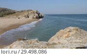 Купить «Waves wash the sandy shore. Ridge is broken on the rocks», видеоролик № 29498086, снято 26 марта 2019 г. (c) Константин Мерцалов / Фотобанк Лори