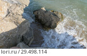 Купить «Waves wash the sandy shore. Ridge is broken on the rocks», видеоролик № 29498114, снято 26 марта 2019 г. (c) Константин Мерцалов / Фотобанк Лори