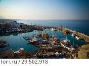 Купить «Aerial view to Girne marina, North Cyprus», фото № 29502918, снято 2 ноября 2013 г. (c) Сергей Майоров / Фотобанк Лори