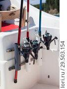 Купить «Удочки для ловли рыбы в держателях на лодке», фото № 29503154, снято 23 июля 2018 г. (c) Кекяляйнен Андрей / Фотобанк Лори