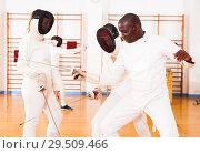 Купить «Fencers exercising techniques in battle», фото № 29509466, снято 11 июля 2018 г. (c) Яков Филимонов / Фотобанк Лори