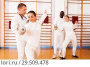 Купить «men and women fencers posing with foils togethe», фото № 29509478, снято 11 июля 2018 г. (c) Яков Филимонов / Фотобанк Лори