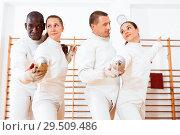 Купить «Men and women fencers practicing movements together at fencing workout», фото № 29509486, снято 11 июля 2018 г. (c) Яков Филимонов / Фотобанк Лори