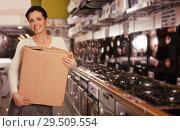 Купить «Female with packed purchases in store», фото № 29509554, снято 21 февраля 2018 г. (c) Яков Филимонов / Фотобанк Лори