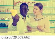 Купить «druggist helping girl picking up prescription medicines», фото № 29509662, снято 2 марта 2018 г. (c) Яков Филимонов / Фотобанк Лори