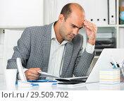 Купить «Male having lot of work and problems», фото № 29509702, снято 3 мая 2017 г. (c) Яков Филимонов / Фотобанк Лори