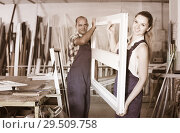Two professional workers working in assembly shop of plastic windows. Стоковое фото, фотограф Яков Филимонов / Фотобанк Лори