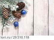 Купить «С Новым годом и Рождеством. Еловые ветки, новогодние шары и шишки. Праздничная открытка», фото № 29510118, снято 2 декабря 2018 г. (c) Наталья Осипова / Фотобанк Лори