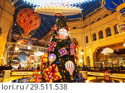 Купить «New Year's decoration in GUM (The main department store), Moscow, Russia», фото № 29511538, снято 2 декабря 2017 г. (c) Наталья Волкова / Фотобанк Лори