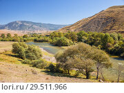 Купить «Picturesque landscape of the Kura River in Samtskhe-Javakheti, Georgia. Sunny early autumn day», фото № 29511966, снято 25 сентября 2018 г. (c) Юлия Бабкина / Фотобанк Лори