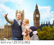 Купить «family taking selfie by smartphone in london city», фото № 29512062, снято 12 октября 2014 г. (c) Syda Productions / Фотобанк Лори