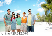 Купить «friends in sunglasses over exotic beach background», фото № 29512070, снято 30 июня 2018 г. (c) Syda Productions / Фотобанк Лори