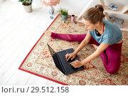 Купить «woman with laptop computer at yoga studio», фото № 29512158, снято 21 июня 2018 г. (c) Syda Productions / Фотобанк Лори