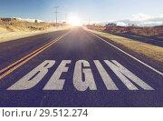 Купить «close up of word begin on suburban asphalt road», фото № 29512274, снято 3 марта 2018 г. (c) Syda Productions / Фотобанк Лори